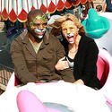 """Project Runway"" host and supermodel Heidi Klum and her singer-husband Seal in crazy jungle animal facepaint on Dumbo the Flying Elephant at Disneyland."