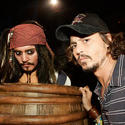 """Pirates of the Caribbean"" star Johhny Depp side by side with a Jack Sparrow animatronic inside the Disneyland ride."