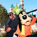 Basketball star Kobe Bryant celebrates a Los Angeles Lakers championship with Goofy at Disneyland.