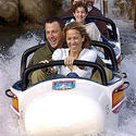 Seven-time Tour De France champ Lance Armstrong with one-time singer-girlfriend Sheryl Crow splashes down on the Matterhorn at Disneyland.