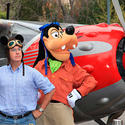 Talk show host Stephen Colbert sports Mickey ears with pilot Goofy at Disney California Adventure.