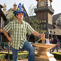 """The Office"" star Steve Carrell tries to remove the sword from the stone in Fantasyland at Disneyland."