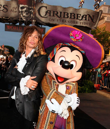 "Aerosmith singer and ""American Idol"" judge Steven Tyler strikes a pose with Mickey Mouse during the red carpet premiere of ""Pirates of the Caribbean: On Stranger Tides"" at Disneyland."