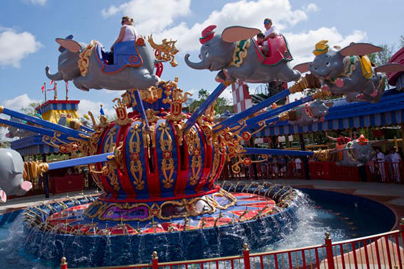 The recently-rehabbed Dumbo the Flying Elephant attraction takes riders for a spin in the new Fantasyland at the Magic Kingdom.