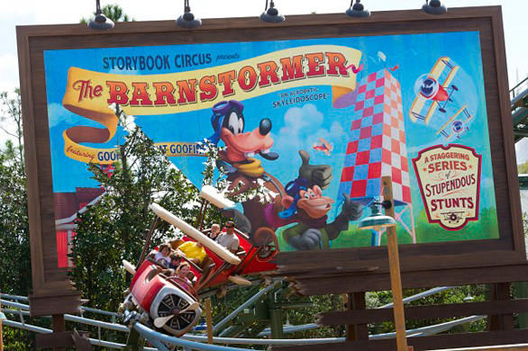 The Great Goofini roller coaster races through a billboard cutout in the new Fantasyland at the Magic Kingdom.