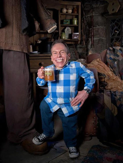 Actor Warwick Davis, who portrayed Professor Filius Flitwick in the movies, samples a foaming tankard of Butterbeer at the Making of Harry Potter tour at Warner Bros.' studios in England.