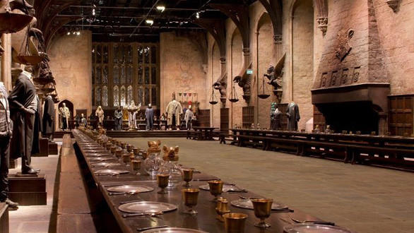 The oak and pine house tables in the Great Hall on the Warner Bros. Making of Harry Potter tour have been aged with axes and chains and carved with graffiti by Hogwarts pupils.
