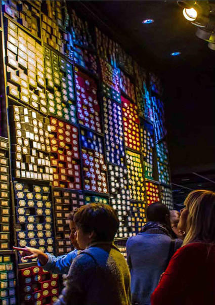 "Visitors peruse shelves filled with magic wand boxes bearing the names of ""Harry Potter"" actors and their characters at the Making of Harry Potter tour at Warner Bros.' studios in England."