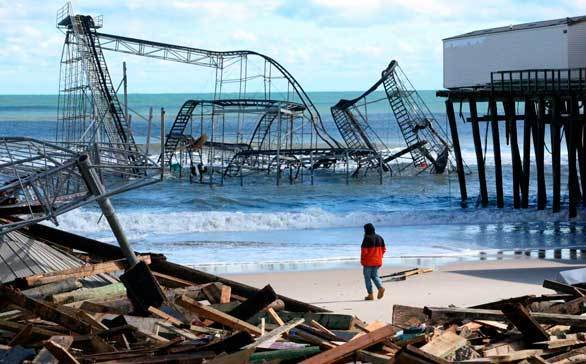 A man looks over the debris on the Seaside Heights, N.J., beach near Casino Pier after Hurricane Sandy slammed into the coast.