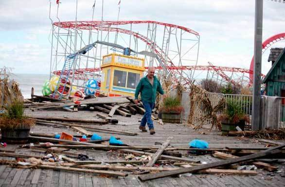 Owner Billy Major surveys the damage on the FunTown Pier in Seaside Heights, N.J., where only four rides survived Superstorm Sandy.