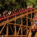 With a running time of more than four minutes, the 7,359-foot-long terrain-hugging ride, known as Beast, is the longest wooden coaster in the world.