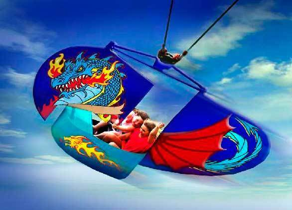 The Surfside Glider coming to Knott's Berry Farm in 2013 is a flying scooter ride with a vehicle suspended from a cable that riders control with a rudder. (Shown: Dragon Flyer at Castle Park)
