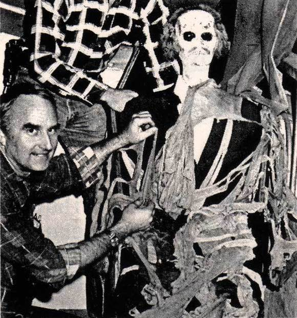 Ride decorator John Waite adds set dressing to the Mine Train for Halloween Haunt at Knott's Berry Farm in 1977.