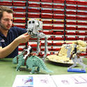 "A Lego model maker builds an AT-ST walker for the new ""Star Wars"" area at Legoland California."
