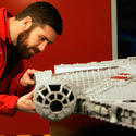 "A Lego model maker builds the Millennium Falcon for the new ""Star Wars"" area at Legoland California."