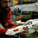 "A Lego model maker inspects an X-Wing starfighter for the new ""Star Wars"" area at Legoland California."