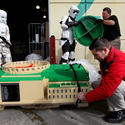 Stormtroopers help assemble a Naboo hangar for the Star Wars miniland at Legoland California.