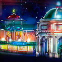 A rendering of the Little Mermaid ride building's exterior, showing the structure glowing at night.