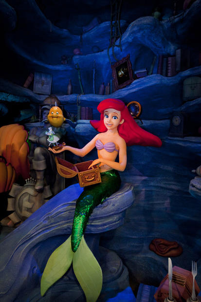 Ariel examines her treasures in the Little Mermaid ride at Disney California Adventure.