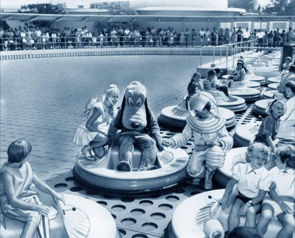 Pluto takes a test drive on the short-lived Flying Saucers ride at Disneyland during the mid-1960s.