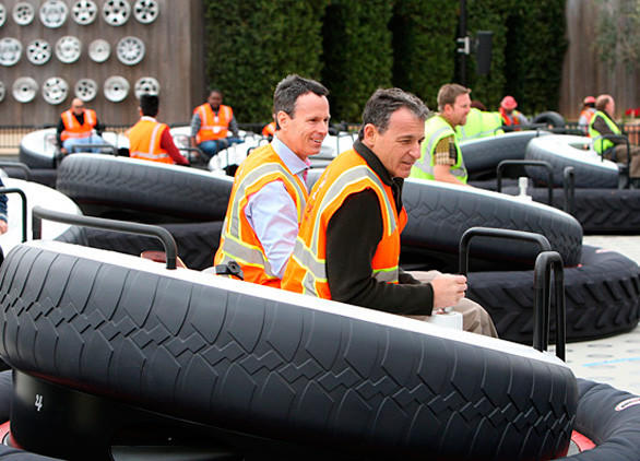 Disney parks chairman Tom Stagg and Disney CEO Bob Iger take a test flight on Luigi's Flying Tires in Cars Land at Disney California Adventure.