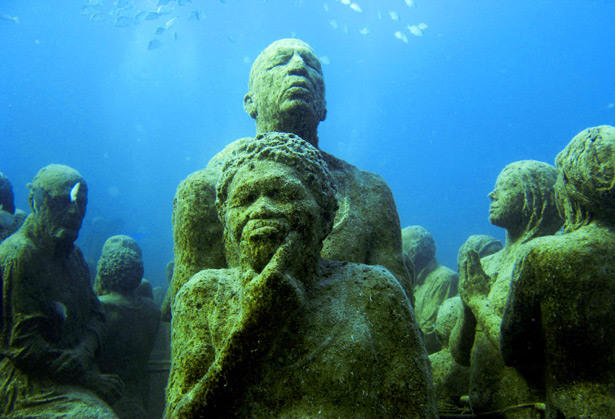 "The Cancun Underwater Museum, which opened Nov. 26, features 400 life-size concrete sculptures. It's free, but visitors are recommended to go with tour operators. <br /> <a href=""http://www.latimes.com/travel/deals/la-trb-offbeat-cancun-underwater-museum,0,1381420.photogallery""><span class=""center_label"">More photos...</span></a>"