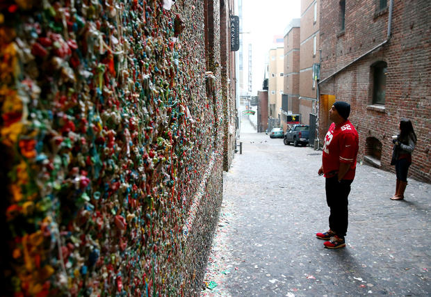 The Gum Wall, in Pike Place Market, originated in the 1990s when Market Theater patrons began sticking their chewed gum on the venue's wall as they waited for shows to start. Theater owners tried to remove the gum, but they eventually gave up as the wall began to be known as a tourist attraction. The wall of vintage gum rises 15 feet high and stretches across about 50 feet. When you think of all the mouths that these pieces of chewed gum came from, you won't be in the mood for smooching.