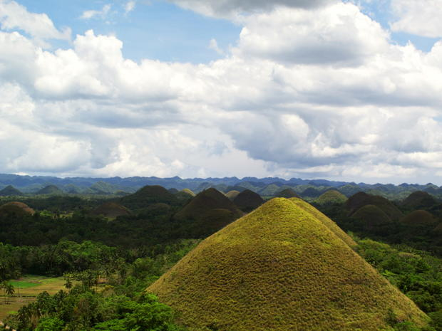 "Unlike most destinations, the Chocolate Hills are best viewed when they're dried and brown. This is when the hills, located in Bohol Province, Philippines, start to earn their name. During the dry season, the normally green grass covering the cone-shaped mounds turns brown, creating fields of chocolate-colored hills. <a href=""/travel/deals/la-trb-offbeat-traveler-chocolate-hills-in-bohol-philippines-20120521,6620065,6550220.photogallery""><span style=""color: #2262CC;"">More photos...</span></a>"