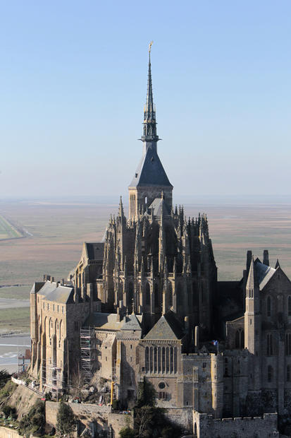 "Up until a few years ago, quirky Mont St. Michel, a tidal island (tides vary as much as 50 feet) located off the coast of Normandy, France, was in danger of losing its maritime identity. In the 8th century, a bishop established a small chapel there. A Gothic abbey, used during the French Revolution as a prison, followed a few centuries later. Then in the 19th century a causeway connecting the island to the mainland was built, preventing the sea from washing away silt that collected around the island. A dam that rose in 1969 had a similar effect. Land slowly crept up on the island. Now Mont St. Michel, which receives almost two and a half million visitors a year, is undergoing a face-lift aimed at turning back the accumulated sands of time. <a href=""/travel/deals/la-trb-offbeat-traveler-mont-st-michel-france-20121022,3,5064372.photogallery""><span style=""color: #2262CC;"">More photos...</span></a>"