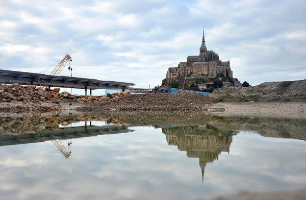 The new bridge, scheduled to be completed in 2014, will cater to pedestrians and shuttles carrying visitors to and from Mont St. Michel.