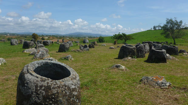 "The Plain of Jars, located on the Xieng Khouang plateau in northern Laos about 100 miles northeast of Vientiane, is composed of thousands of stone jars arranged in clusters. The jars, ranging from a few feet in height to almost 10 feet, were carved about 2,000 years ago, and archaeological evidence suggests they were used in burial rituals. The site was bombed extensively during the Vietnam War, so only certain parts of the area are safe for sightseeing.  <a href=""/travel/deals/la-trb-offbeat-traveler-plain-of-jars-in-laos-20130218-photos,0,628567.photogallery""><span style=""color: #2262CC;"">More photos...</span></a>"
