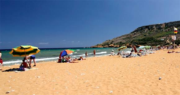 "The beach is known to locals as Red Sandy Beach and can be found on the northeastern side of the island. Besides the extraterrestrial-like orange-reddish sand, Ramla Bay is known for the Roman ruins buried beneath its surface. Calypso Cave, overlooking the bay, has also been associated with the mythical lair of Calypso in Homer's ""Odyssey."" <a href=""/travel/deals/la-trb-offbeat-traveler-red-sandy-beach-malta-20110805,0,4134275.photogallery""><span style=""color: #2262CC;"">More photos...</span></a>"