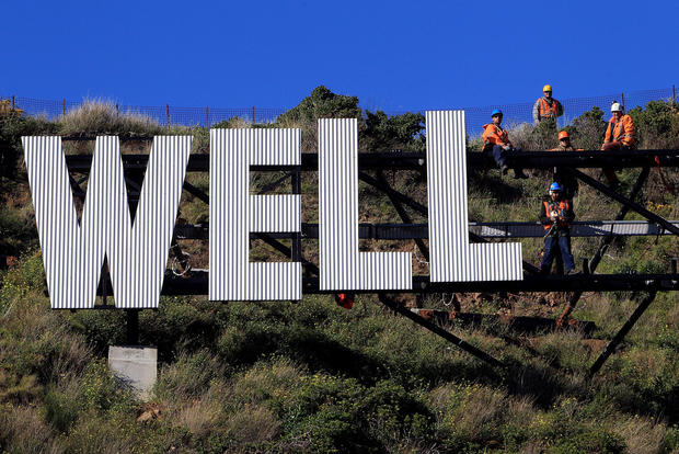 "Workers assemble ""Wellington Blown Away."" The sign was designed by Matt Sellas and Raymond McKay of the advertising agency Saatchi & Saatchi."