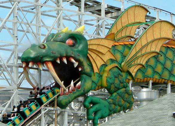 Built in 1929 at Playland Park in Rye, N.Y., the Dragon out-and-back wooden coaster features a distinctive dragon's mouth tunnel entrance.