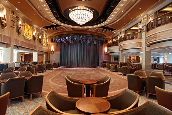 The grand ballroom called the Queens Room features live music and dancing by night.