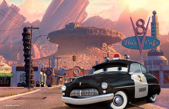 The Sheriff guards the town of Radiator Springs, with Casa Della Tires on the left, Flo's V8 Cafe on the right and the courthouse in the distance.