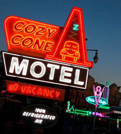 The Cozy Cone Motel neon sign lit up at night in Cars Land at Disney California Adventure.