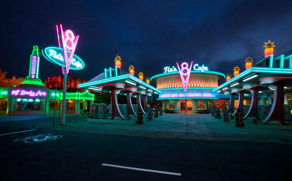 The neon trim of Flo's V8 Cafe lights up at night in Cars Land at Disney California Adventure.