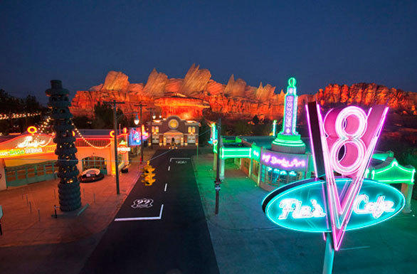 A bird's eye view of the neon-lit Route 66 in Cars Land at Disney California Adventure.