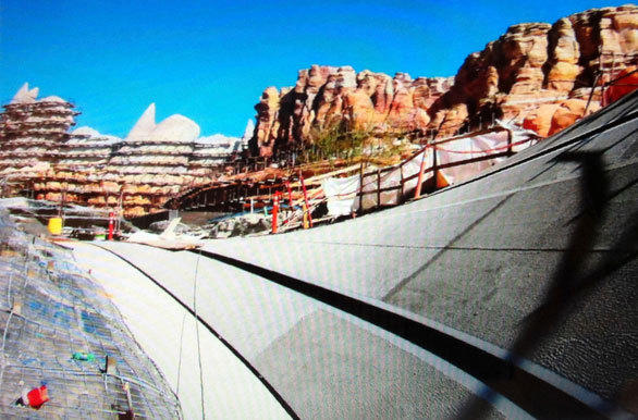 The man-made mountain range rises above the slotted track of the Radiator Springs Racers ride at Disney California Adventure.