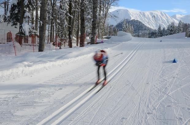 Cross-country racers like this one in Krasnaya Polyana, Sochi, prefer the smooth ride that comes with following previous tracks.