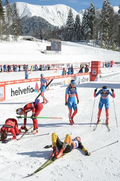 Just beyond the finish line, some World Cup cross-country racers collapse, while others  just glide. The race took place on the mountain at Krasnaya Polyana, Sochi.
