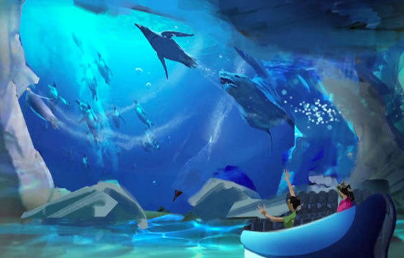 A predator chases a penguin on a video screen inside the new Antarctica: Empire of the Penguins attraction coming to SeaWorld Orlando.