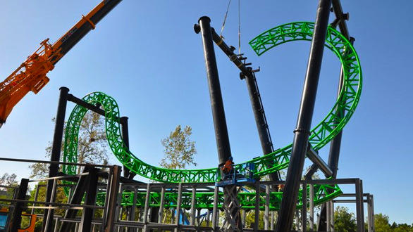 Crews install the first sections of the Green Lantern track at Six Flags Magic Mountain.