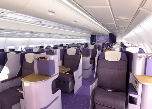 Seats in business class, each 20 inches wide, have direct aisle access and can recline to a fully flat position. Passengers also have access to a 15-inch viewing screen.