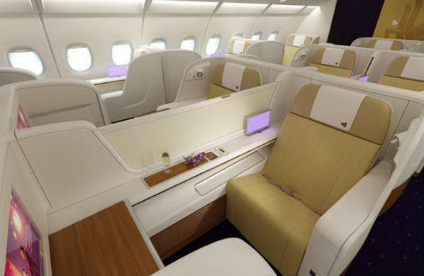 Each seat in first class is 26.5 inches wide and comes with Wi-Fi access, a 23-inch viewing screen and an in-seat power supply. Passengers have access to larger toilets, and one of the lavatories has a dressing area.
