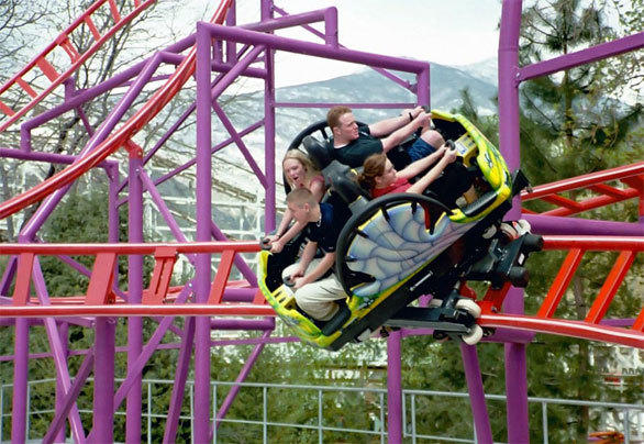A spinning car navigates the 360-degree carousel spin element on the Maurer Sohne spinning coaster at Utah's Lagoon amusement park.