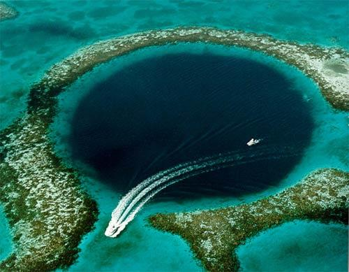 "There are many blue holes off the coast of Belize, but the ""great"" Blue Hole on Lighthouse Reef Atoll is the one most visible in a flyover -- and the most famous one for diving. The hole is about 1,000 feet in diameter and 412 feet deep.<br> <br> -- Los Angeles Times"