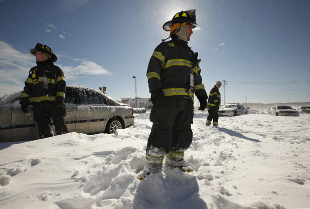 Members of the Nissequogue Fire Department assist stranded motorists along Nesconset Highway in Stony Brook, on Long Island's North Shore.