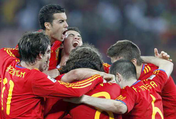 Players for Spain celebrate after taking a 1-0 lead late in their World Cup semifinal match against Germany on Wednesday.